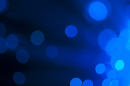 blur effect: Blue and green festive lights and circles background. Blurred christmas lights