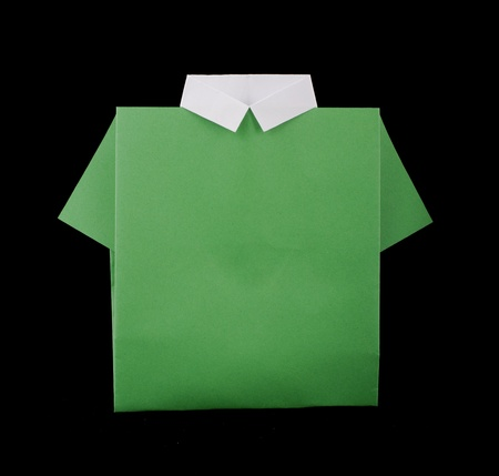 origimi: Isolated paper made green shirt.Folded origami style Stock Photo