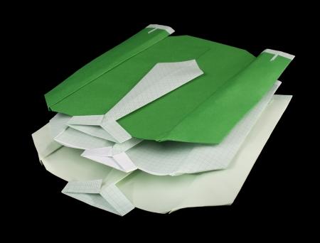 Isolated paper made shirts on pile.Folded origami style Stock Photo - 16513833