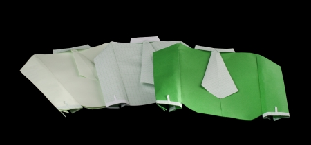 origimi: Isolated paper made shirts on pile.Folded origami style Stock Photo