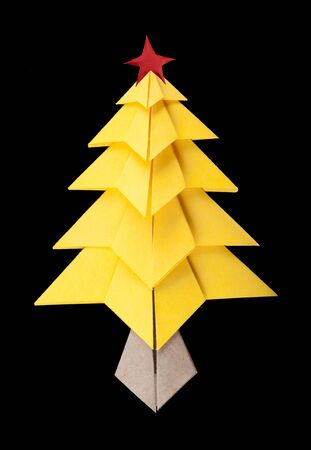 Yellow christmas tree black isolated  origami Stock Photo - 16513879