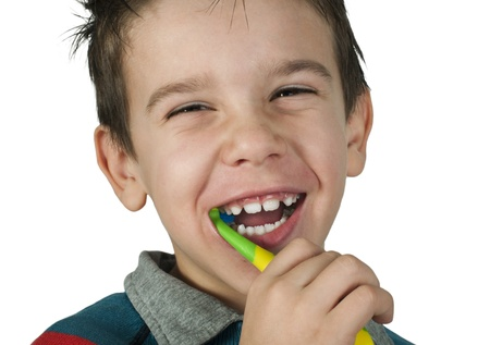 Boy brushing his teeth. White isolated Stock Photo - 16513737