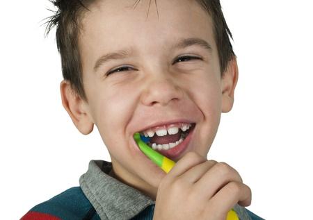 Boy brushing his teeth. White isolated Stock Photo - 16513737
