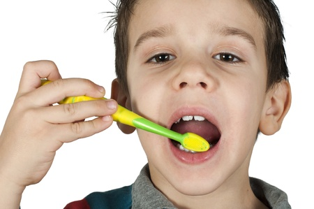 Boy brushing his teeth. White isolated Stock Photo - 16513707