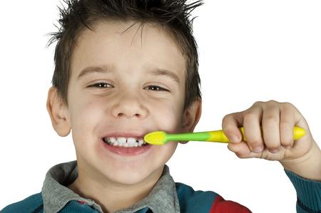 Boy brushing his teeth. White isolated Stock Photo - 16513712