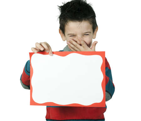 Boy who laughs and holds white board. White copy spice Stock Photo - 16513774