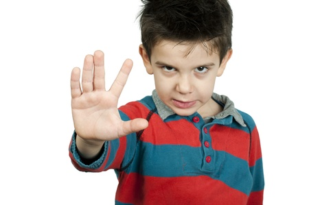 Little boy showing stop with his hand  White isolated Stock Photo - 16513735