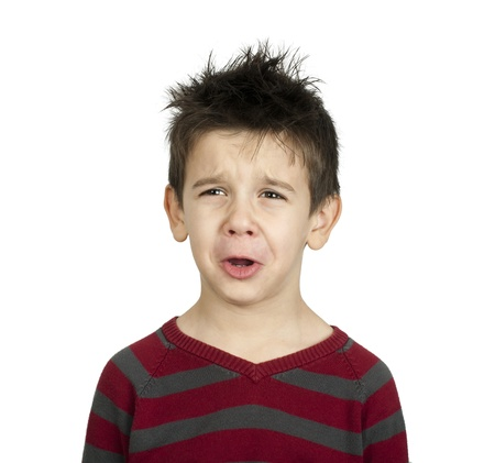 Whiny little boy close up  White isolated crying child Stock Photo