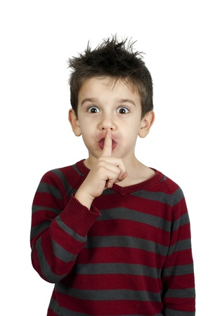 Little boy showing silence symbol Stock Photo