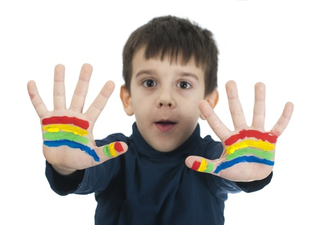 Boy hands painted with rainbow colors. White islated smiling child Stock Photo - 16625718
