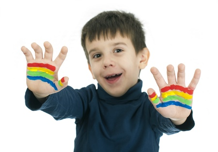 Boy hands painted with rainbow colors. White islated smiling child Stock Photo - 16625717