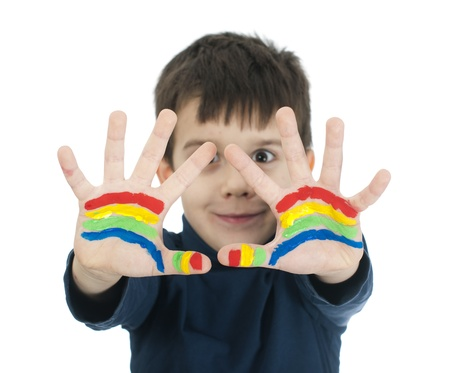 Boy hands painted with rainbow colors. White islated smiling child Stock Photo - 16625699