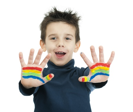 Boy hands painted with rainbow colors. White islated smiling child Stock Photo - 16625674