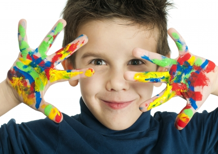 Boy hands painted with colorful paint. White islated smiling child