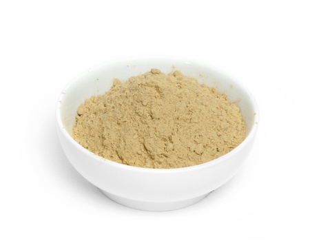 Powdered ginger in a bowl white isolated Standard-Bild