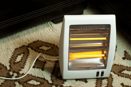 halogen: Electric heater with halogen coils. Heater on thick carpet