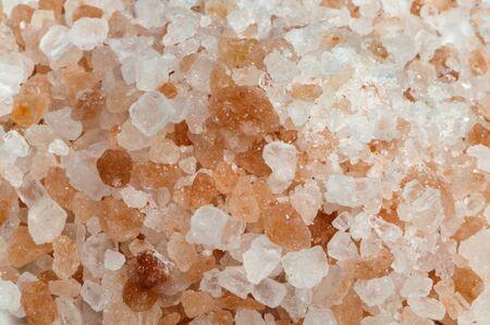 Natural coarse salt close up background