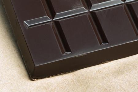 cikolata: Chocolate bar in packaging of paper bag.  Stock Photo