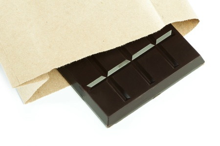 cikolata: Chocolate bar in packaging of paper bag. White isolated Stock Photo