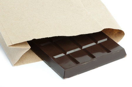 Chocolate bar in packaging of paper bag. White isolated Stock Photo