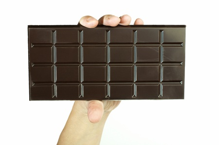 Hand holding chocolate bar. White isolated