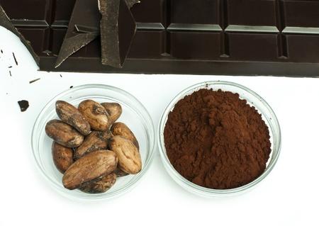 cikolata: Cocoa beans, cocoa powder in bowls and chocolate bar white isolated Stock Photo