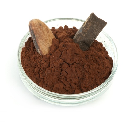 Cocoa bean, cocoa powder in bowls and piece of chocolate white isolated