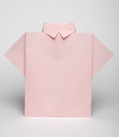origimi: Isolated paper made pink shirt. Folded origami style Stock Photo