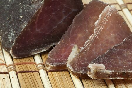 Homemade natural veal dried meat. Cut on a wooden board Stock Photo - 16804178
