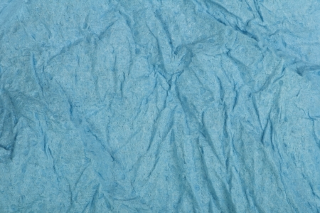 Crumpled blue paper background. photo