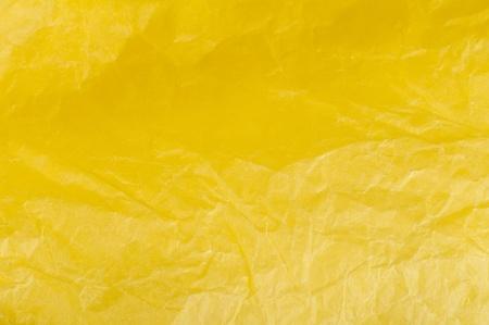 Crumpled yellow paper background. photo