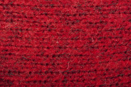 Handmade knit red background. Close up structure of the yarn photo