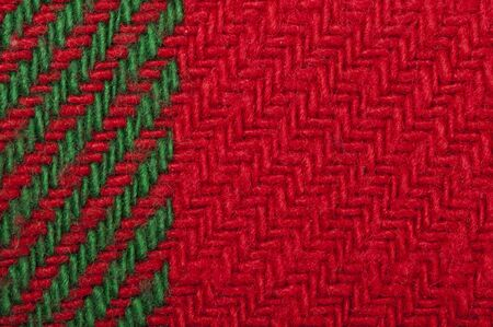Handmade knit green and red background. Close up structure of the yarn. Christmas colors photo