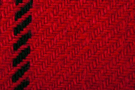 Handmade knit black and red background. Close up structure of the yarn. Christmas colors photo