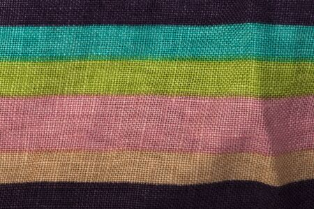 cian: Stamped multicolored lines fabric. Natural linen fabric. Pink, cian, green and beige clors.