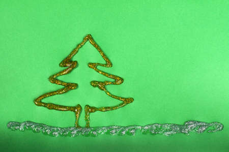 Christmas tree made ​​of shiny gel over green paper photo
