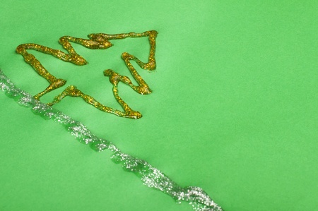 Christmas tree made of shiny gel over green paper photo