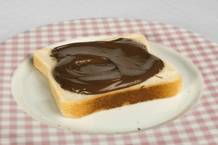 Liquid chocolate on a slice of bread photo