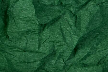 Background of green old crumpled paper photo