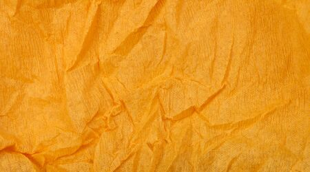 Background of orange old crumpled paper photo