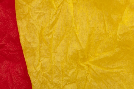 Background of yellow and red old crumpled paper photo