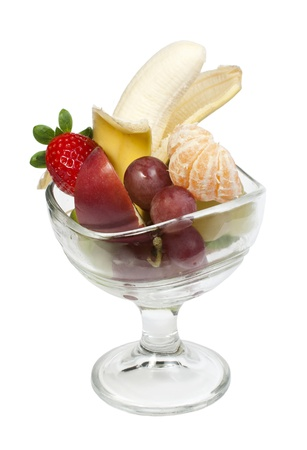 Fruit salad in a glass bowl on white background photo