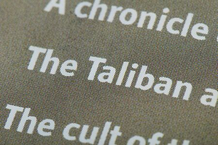 Word taliban on newspaper photo