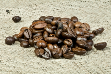 Coffee beans closeup on burlap photo
