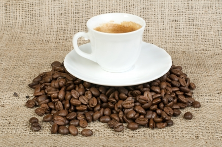 Cup of coffee and coffee beans on burlap Stock Photo - 17268048