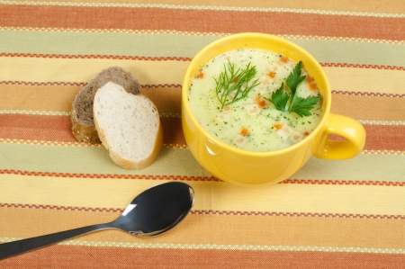 Chicken Cream Soup  Spoon and bread on the table photo