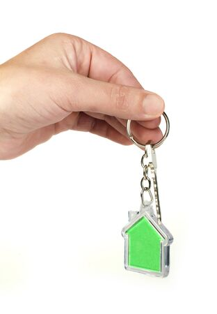 Keychain with figure of green house. Hand holding key and Keychain. Stock Photo - 17267611