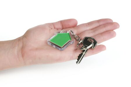 Keychain with figure of green house. Hand holding key and Keychain. Stock Photo - 17267652