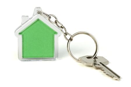 Sleutelhanger met een afbeelding van groene huis Stockfoto