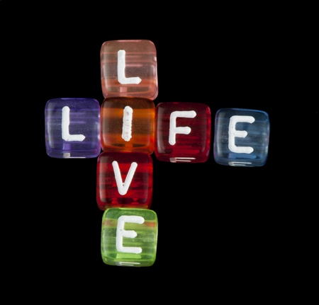 Crossword live life. Black isolated cubes Stock Photo - 17267564